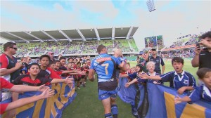 Matt Hodgson runs out for his 100th Super Rugby cap with son Hunter in his arms